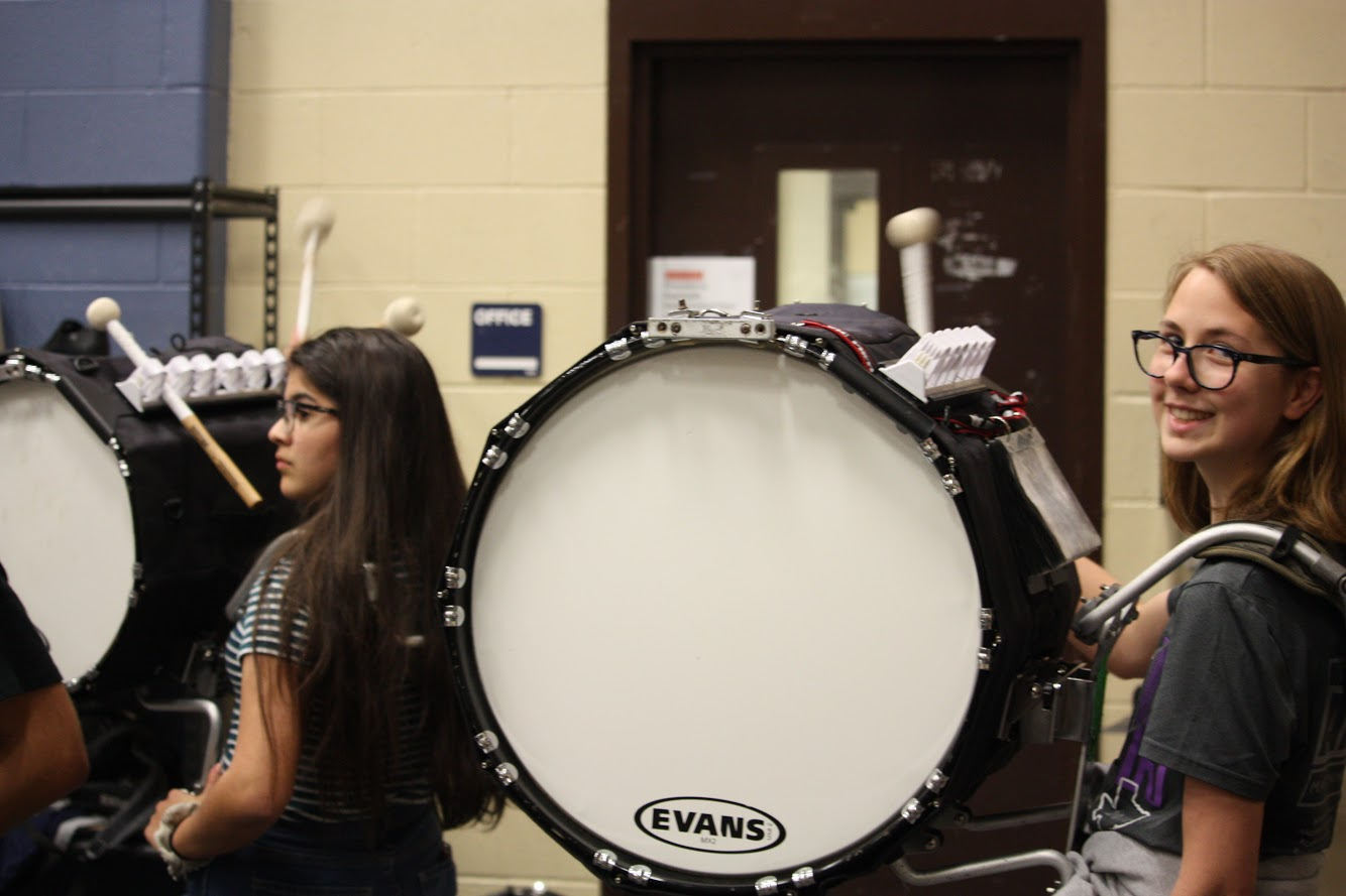 Sophomore+percussionists+Anne+Marie+Williams+and+Caitlyn+Hermesch+prepare+for+the+show.
