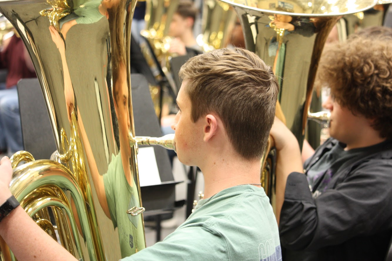 Sophomore+tuba+players+Dalton+Wambles+and+Cole+Lienneweber+play+along+with+the+conductor.