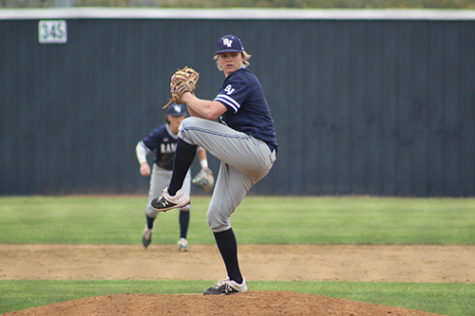 Junior pitcher, Jarek Wells winds-up for a pitch during an early season game.