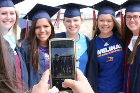 Hannah Kollmansbarger, Carissa Vasquez, Kaylin Kine, Presley Smith and Mackenzie Thornley pose for a photo in front of the school.