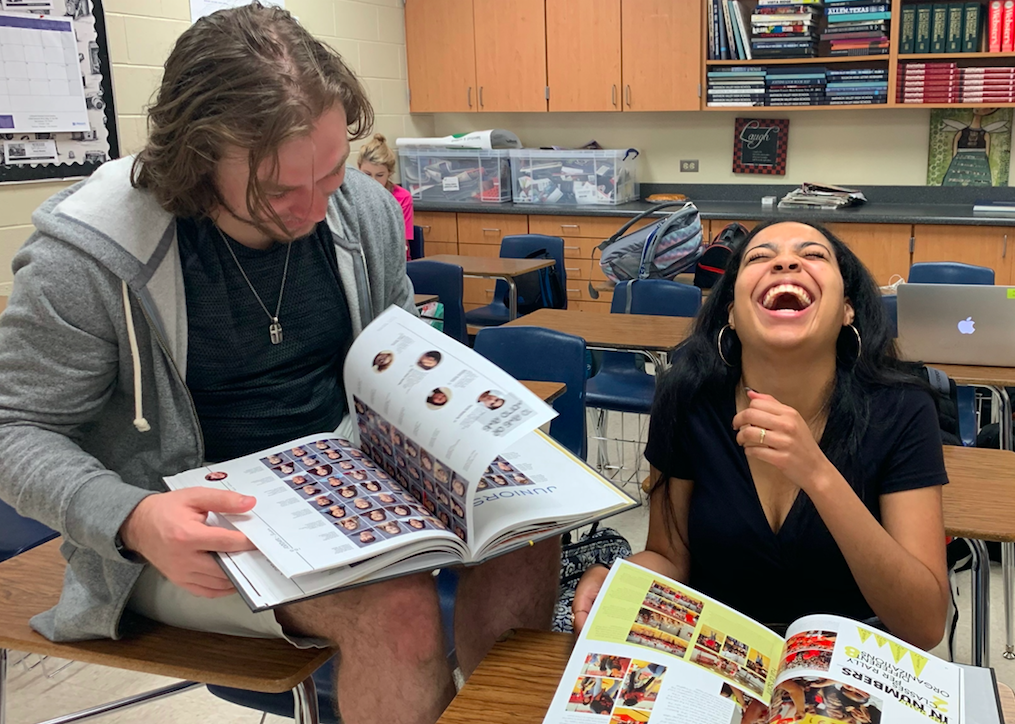 Seniors Jack Mobley and Rebecca Covington flipping through this years yearbook, recalling past books and cherishing their last.