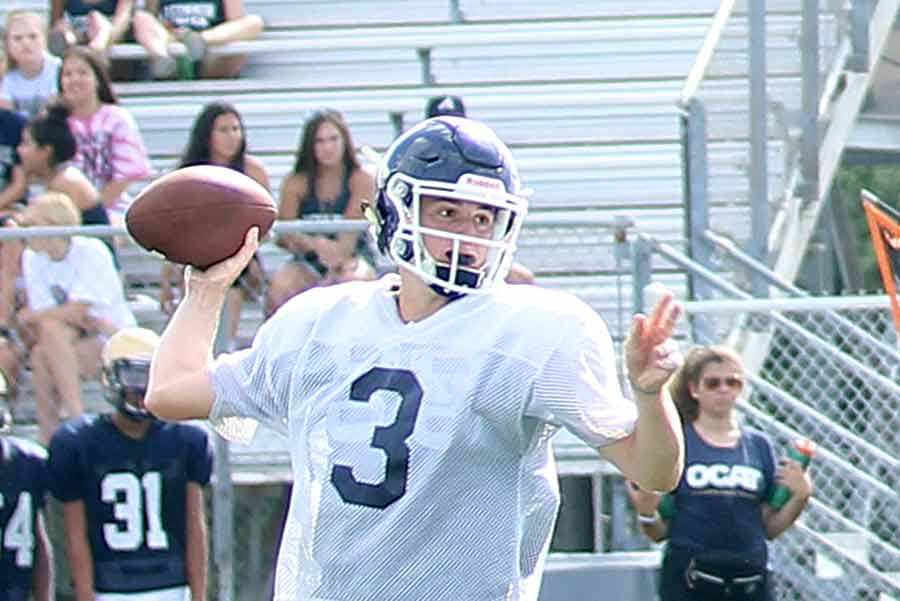 While the football team scrimmages Brandeis on Aug. 23, senior Luke Gombert gets some reps as the new starter.