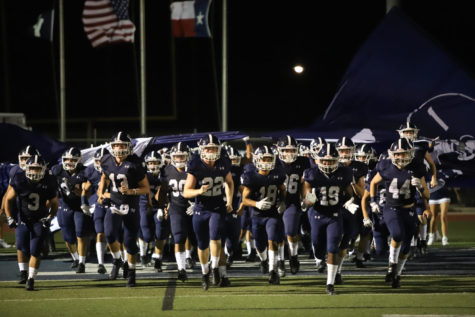 The Rangers run out onto the field prior to last season's 24-23 loss to the Lee Rebels. The two teams face off again in Midland this Friday.