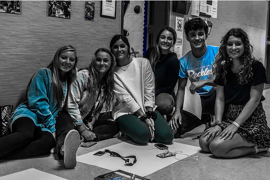 FACS members Karsten Smith, Alyssa Smith, Jenna Kirk, Cassidy Hight, Delaney Deborde, and Kennedy Weakly make posters, for the Oct. 2 blood drive at school. Donors can sign up by texting @oct2blood to 81010.
