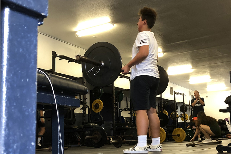 WEIGHT FOR IT - Student athletes hit the weight room during fourth period.