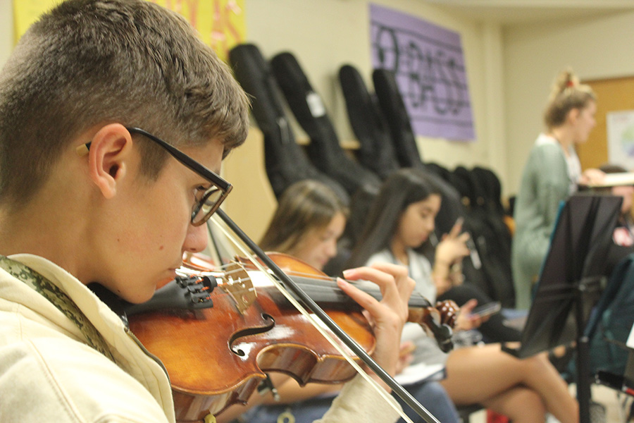 Wyatt Sedlak warms up on his violin during second period orchestra.