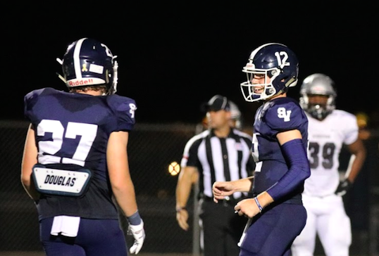 Luke Gombert and Garrett Brooks celebrate a touchdown against Pflugerville Hendrickson. Gombert threw for two touchdowns this week in a win over San Antonio Madison.