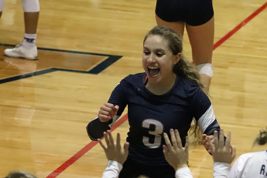 At the district match against East Central, senior libero Ashley Acuna celebrates after a 3-0 win.