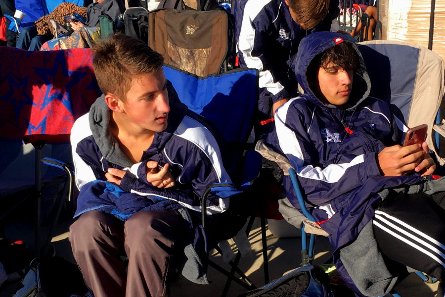 Ranger swimmers Mason Klein (left) and Cole Wagemen try to stay warm at Friday's swim meet. The boys placed 3rd overall at the meet.