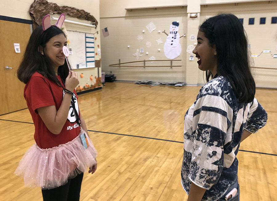 For Meme Day, freshman China Mercado celebrates Spirit Week with friends in the dance room.
