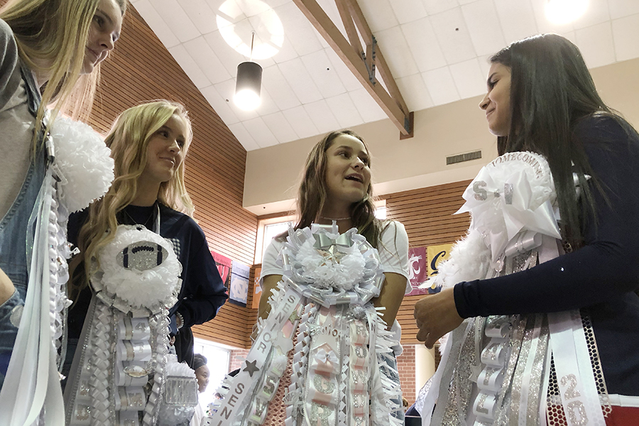 Decked in their homecoming mums, Alena Mercella, Morgan Price, Grace McCarrell and Kaylee Villa talk Friday about their homecoming  plans