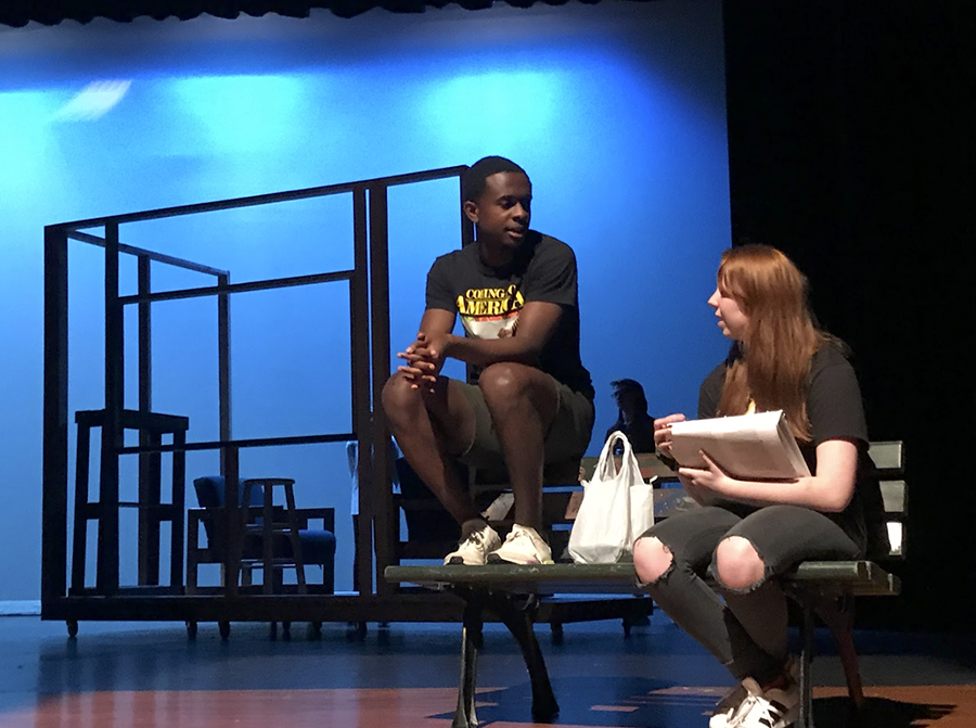 During rehearsal for 'Middletown,' senior Caleb Mosley and junior Brenna Collins converse about their roles.