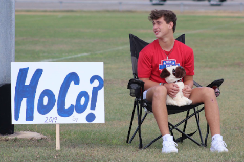 With a series of posters on Sept. 22, freshman Michael Mayhugh invites Zoie Saucedo to the homecoming dance.