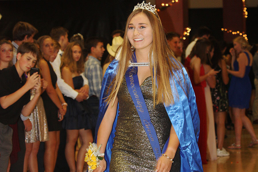 At+Saturday%27s+homecoming+dance%2C+senior+Mackenzie+Ramos+dons+her+cape+and+crown++as+the+2019+homecoming+queen.