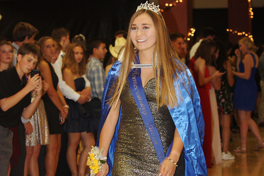 At Saturday's homecoming dance, senior Mackenzie Ramos dons her cape and crown  as the 2019 homecoming queen.
