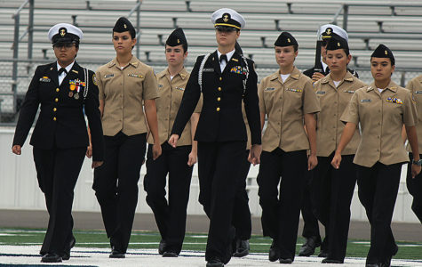During the Veterans Day ceremony Monday at Ranger Stadium, members of the ROTC's armed and unarmed drill teams perform their routines.