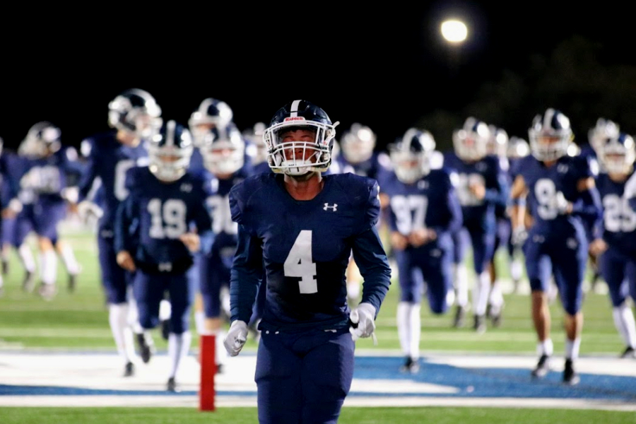 Jalen Nutt charges onto the field before a loss against Steele. Nutt and the Rangers hope to bounce back this week at San Marcos.