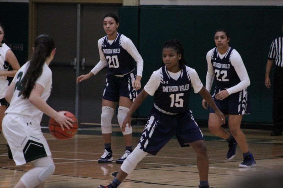 Junior guard Trinity Garrett plays defense against Laredo Alexander High School. Garret set the school career assists record this week with 234.