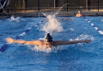 Senior Brianna Houlahan warms up for district competition. The meet will be held on Thursday