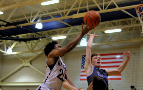 Senior guard Armel Talla attempts a layup against New Braunfels. Talla scored eight points in the 61-54 loss.