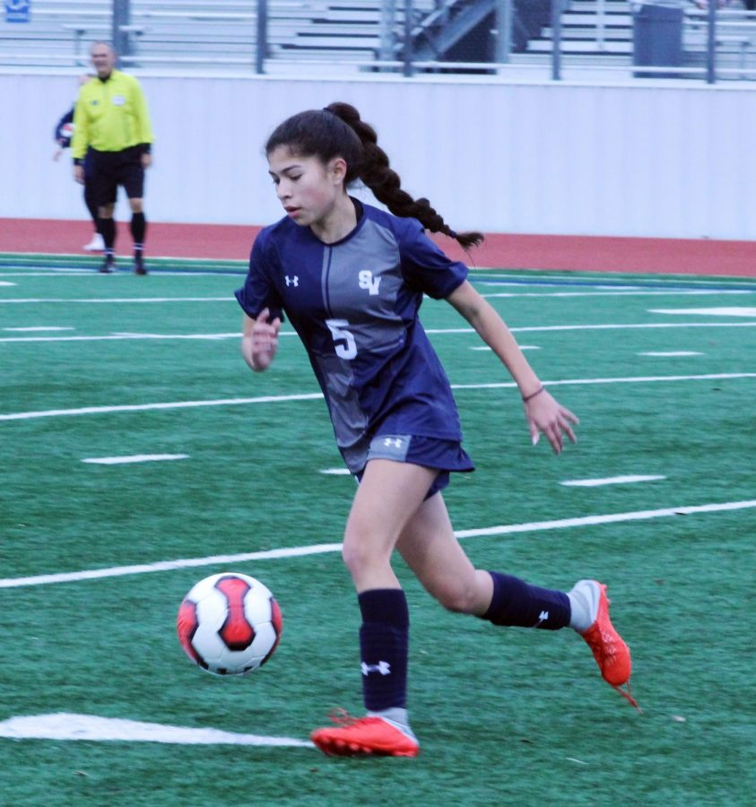 Sophomore Tatianna Herrera takes the ball up the line in a preseason game against Uvalde, in which the Rangers won 10-1.