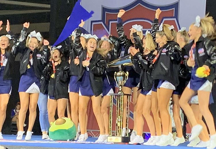 The freshman cheer squad celebrates winning first place at the National Cheer Association competition in Dallas.