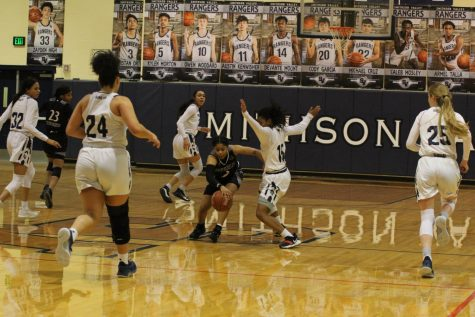Boys' basketball falls in battle with Trojans