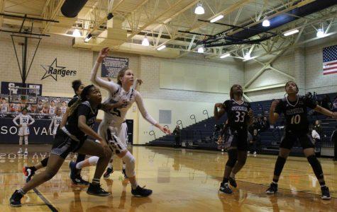 Sophomore Gabby Elliott fights for a rebound during Tuesdays's regular-season finale against Steele. Elliott scored 10 points in last night's loss.