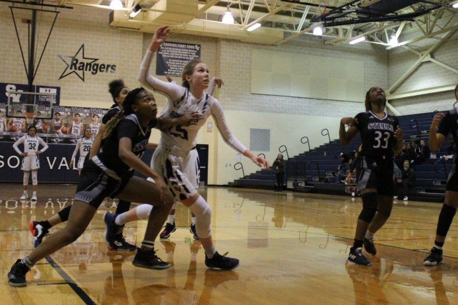 Sophomore Gabby Elliott fights for a rebound during last year's regular-season finale against Steele.