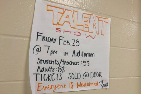 Talent show flyer made by student council hangs in the A wing.