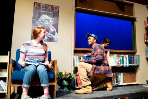 "Senior Caleb Mosley (right) talks with junior Brenna Collins (left) during a performance of ""Middletown."" Along with his theatrical feats, Mosley also plays varsity basketball."
