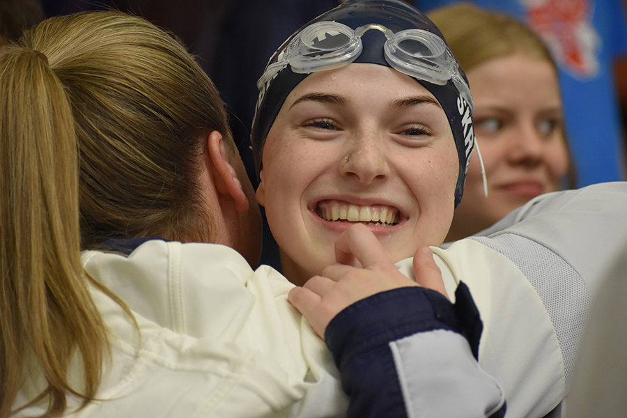 Hugging+Coach+Kari+Osborne%2C+sophomore+Laney+Skrobanek+celebrates+her+gold+medal+finish+in+the+100+meter+backstroke+at+the+region+meet+Saturday+at+the+Josh+Davis+Natatorium.
