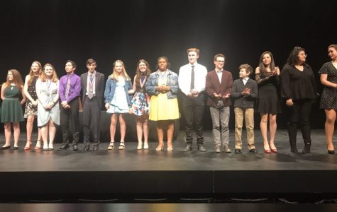 As they stand on the stage, the Clybourne Park cast and crew accept their first place plaque at their most recent contest.
