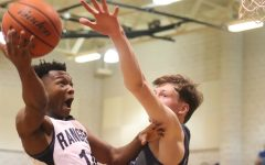 Devante Mount fights for a layup against New Braunfels. Mount was a key starter on basketball's first playoff team in a half-decade.