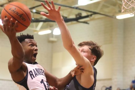Devante Mount fights for a layup against New Braunfels. Mount was a key starter on basketball