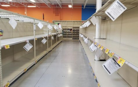 The paper goods aisle at H-E-B stands empty, much as it has since the middle of March.
