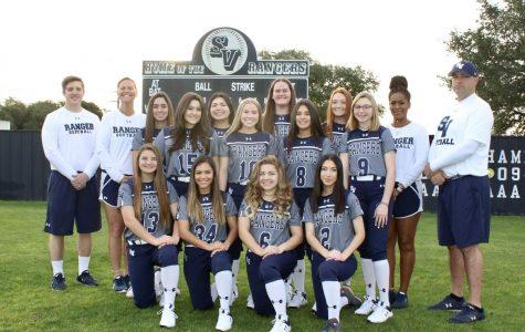 The softball team poses before the 2019-2020 season. The team was 13-6 before COVID-19 shut down the season.