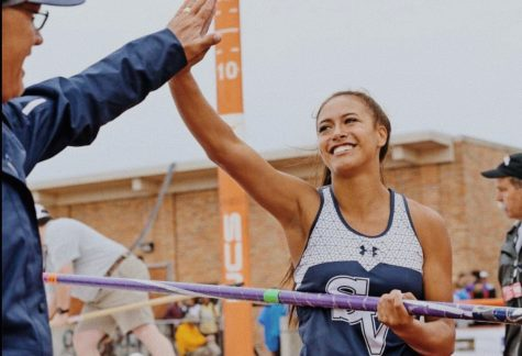 Avianna Trinidad high fives Coach Ulbricht after a good jump