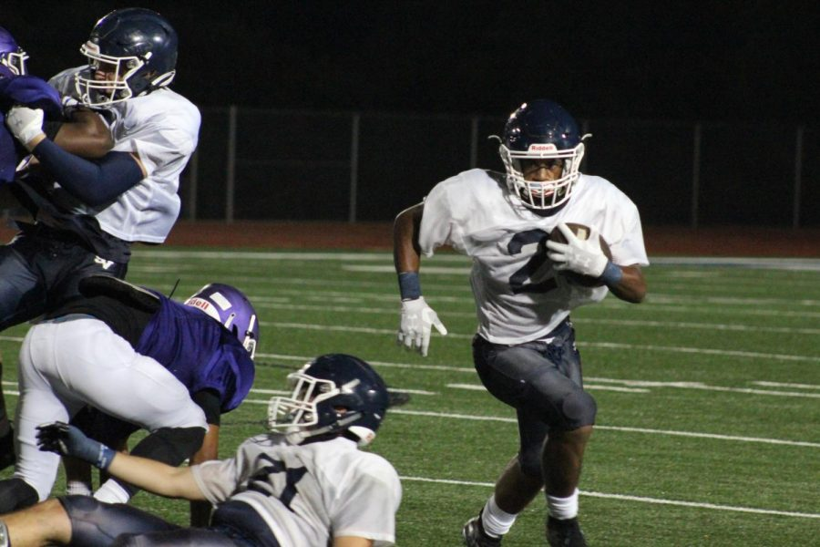 Running back Justin Avery totes the rock against San Marcos. Avery and the rest of the offense clicked Thursday, scoring eight touchdowns.