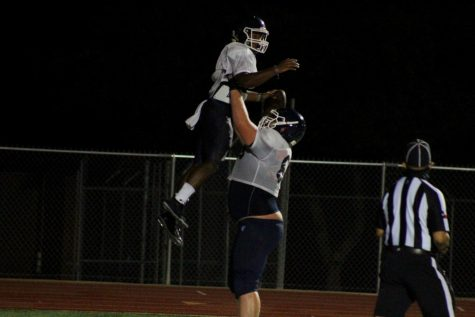 Jalen Nutt and Colton Thomasson celebrate a touchdown during football