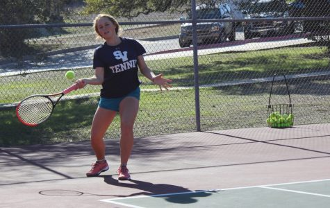 Senior Maddie Haas takes practice swings. She won two sets in the team's 17-4 victory.