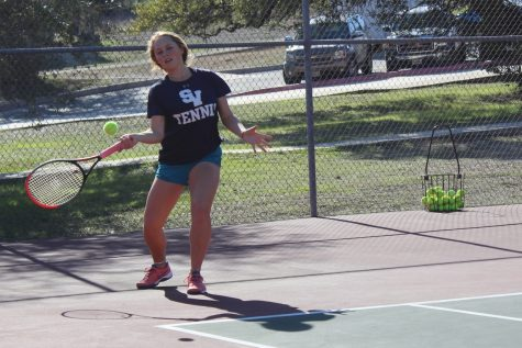 Senior Maddie Haas takes practice swings. She won two sets in the team