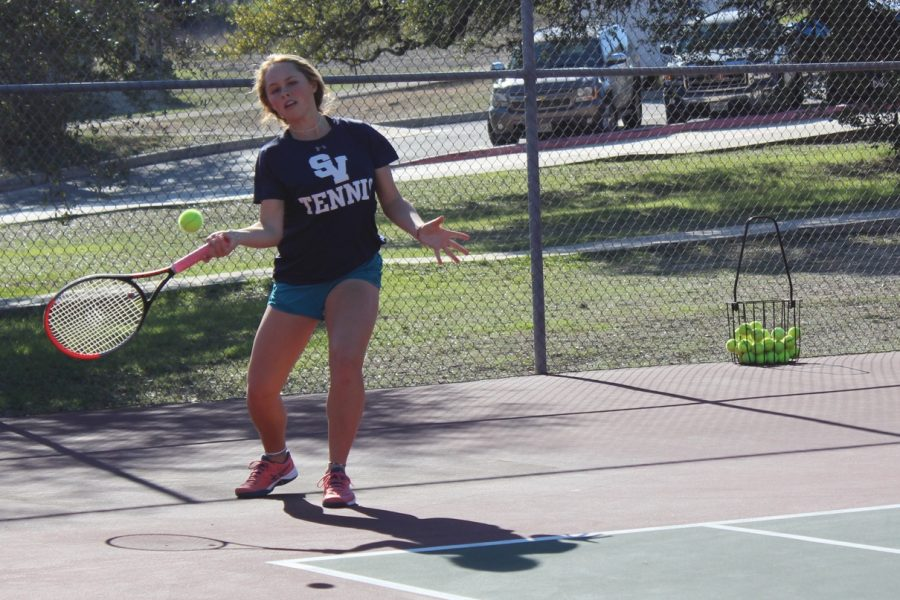 Senior+Maddie+Haas+takes+practice+swings.+She+won+two+sets+in+the+team%27s+17-4+victory.