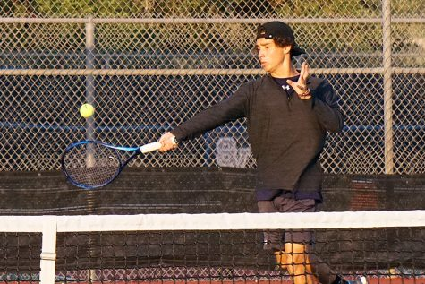 Senior Hayden Rios holds his ground on the court against East Central.