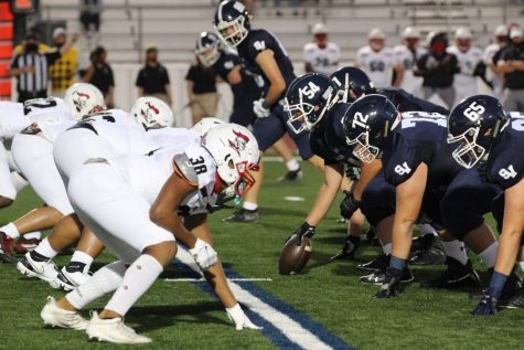 The offensive line sets up against Harker Heights. Football will kick off district play this Friday at Wagner.