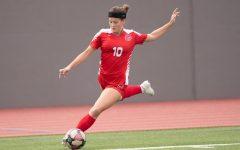 Helene Farris running up to kick a ball