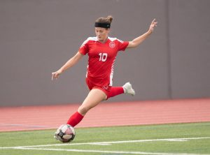Senior forward Helene Farris kicks a ball in her LEE uniform. Farris will play a key role on this year's team.