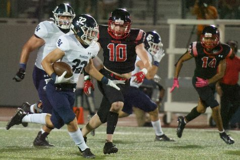 Travis McCracken evades tacklers against Wagner. McCracken rushed for 93 yards and two touchdowns Thursday night against South San.