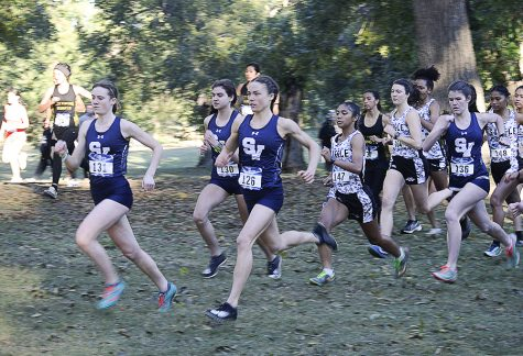 At the district meet on Friday, seniors Sara Scott and Amalie Mills lead the cross country team to another championship and trip to region.