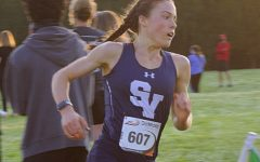 Senior Amalie Mills, soon to commit to the United States Air Force Academy, won first overall at the district meet for cross country.